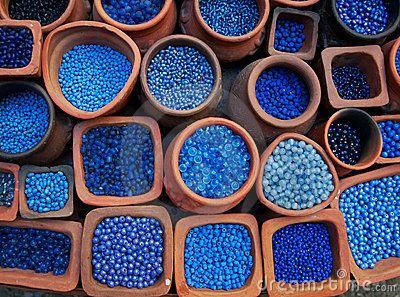 Blue beads in terra cotta pots.
