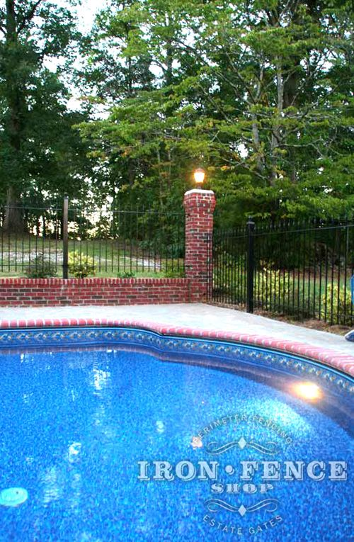 4ft Tall Wrought Iron Fence Installed On A Brick Wall Surrounding A
