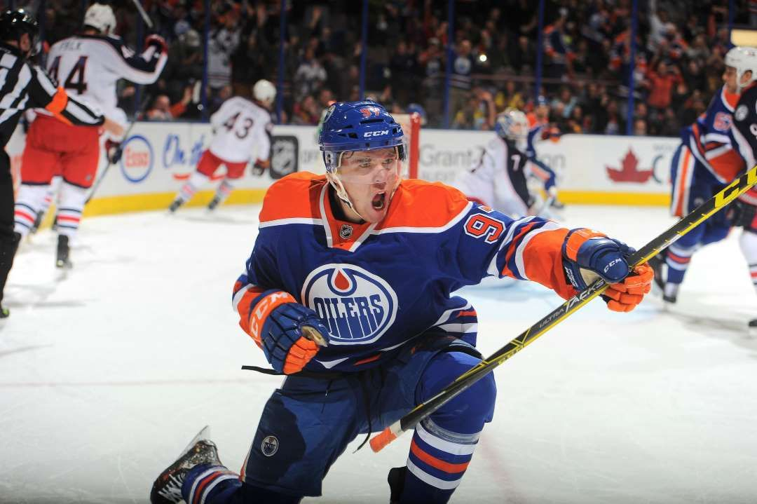 Pumped up:   Connor McDavid #97 of the Edmonton Oilers celebrates after scoring a goal during a game against the Columbus Blue Jackets on Feb. 2 at Rexall Place in Edmonton, Alberta, Canada. The Oilers won 5-1.  -    © Andy Devlin/NHLI/Getty Images
