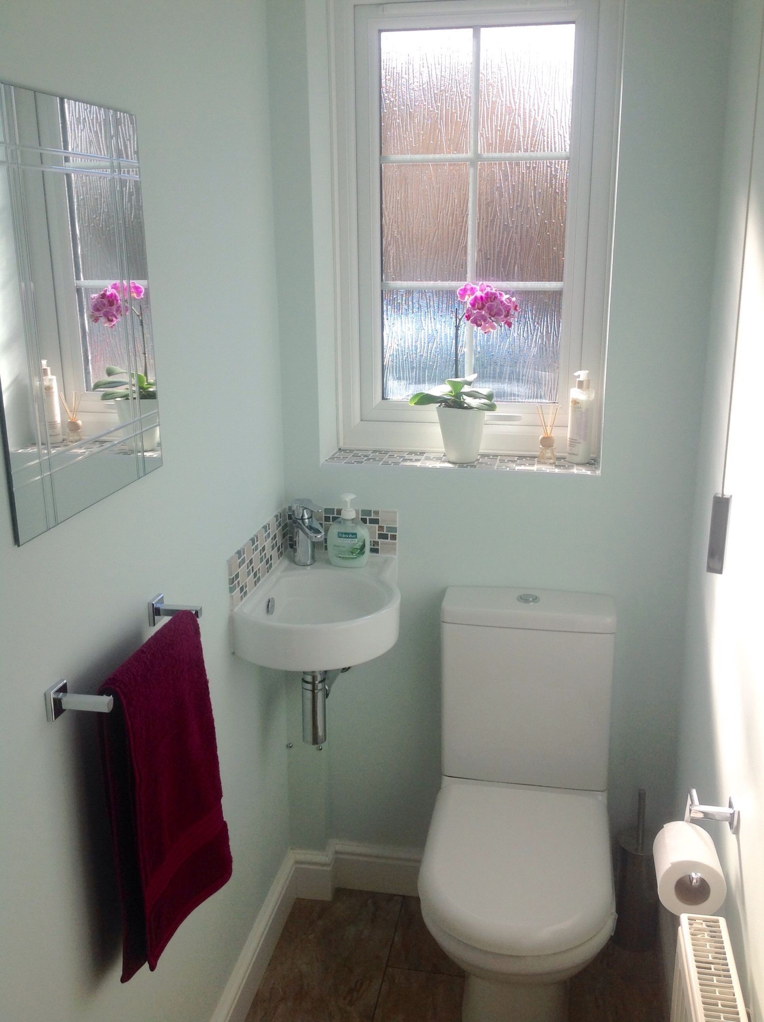 Small Cloakroom With Mosaic Tiles And Corner Sink