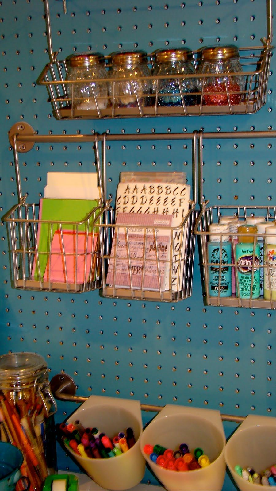 1. Pin boards for craft supplies- awesome 2. Ikea towel bar with ...