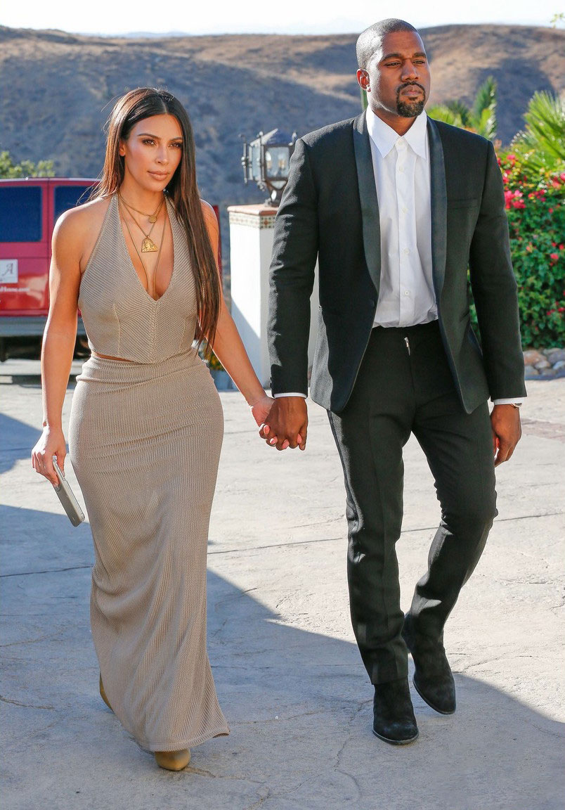 Kanye West Attends Wedding With Kim Kardashian Wearing Saint Laurent Suit And Boots Up Kim Kardashian Outfits Kim Kardashian Dresses Kim Kardashian And Kanye