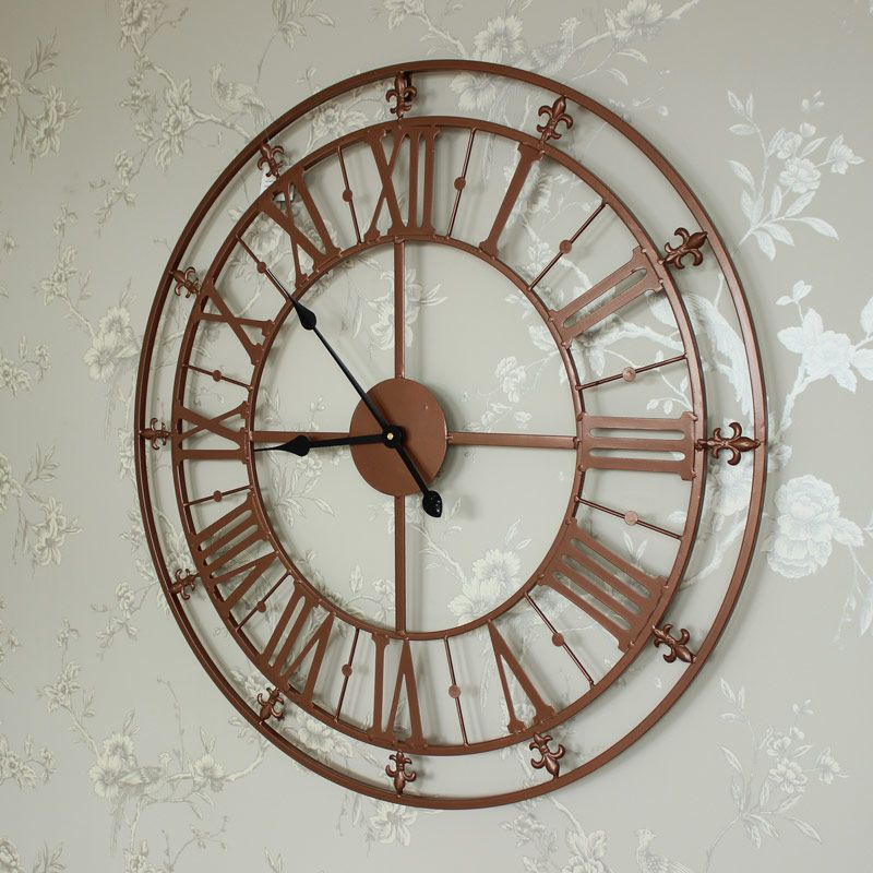 large copper skeleton clock a large skeleton wall clock in a striking copper colour with roman
