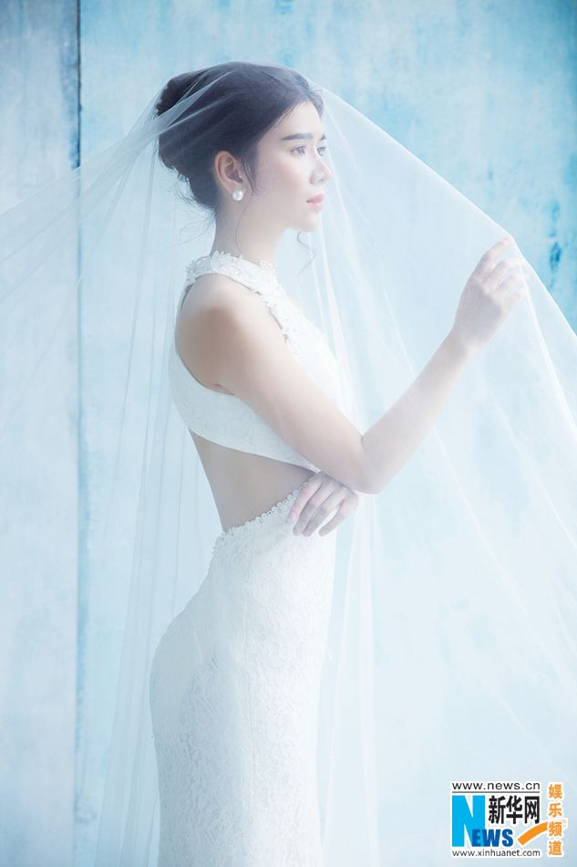Chinese actress wang Di  http://www.chinaentertainmentnews.com/2015/06/wang-di-releases-new-wedding-dress-shots.html
