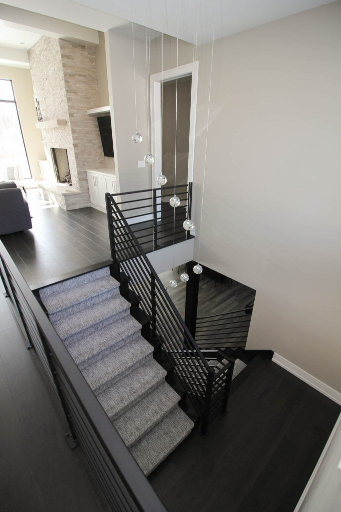 Best Maple Hardwood Flooring And Gray Carpeted Staircase 400 x 300