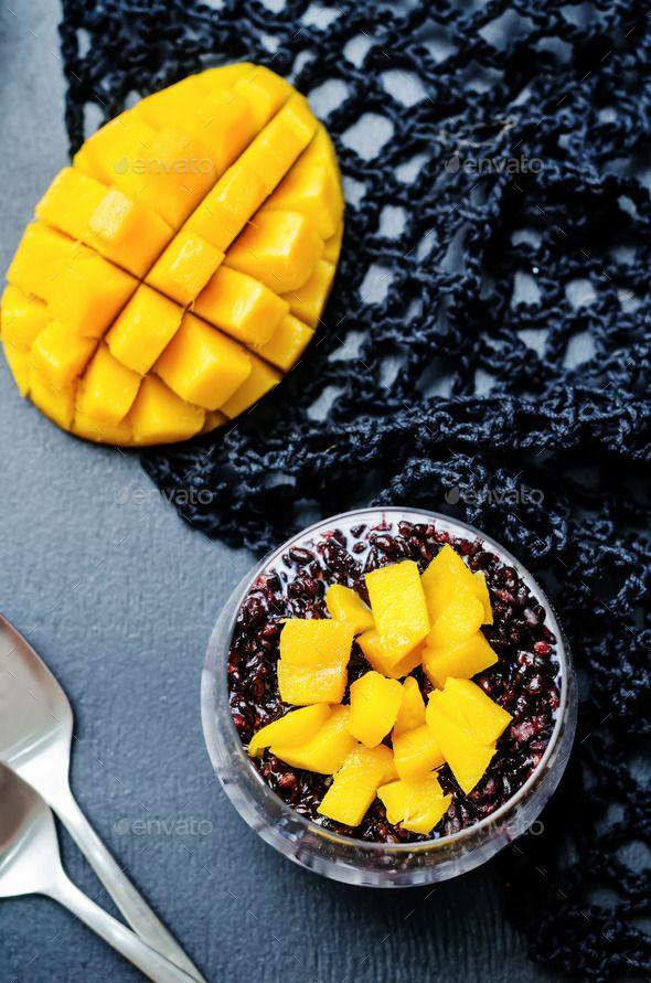 Coconut black rice mango pudding by Arzamasova. Coconut black rice mango pudding on a black background. toning. selective focus #AD #mango, #pudding, #rice, #Coconut