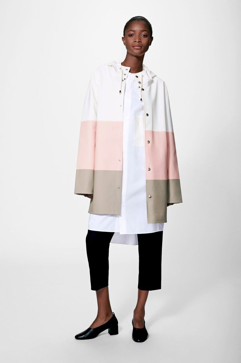 The Stutterheim Stockholm raincoat quotes Alexander Stutterheim's grandfather's original raincoat. It is handmade in our new translucent fabric sourced from Limonta in Italy, comes unlined, with double welded seams, raw hems, snap closures and cotton draw