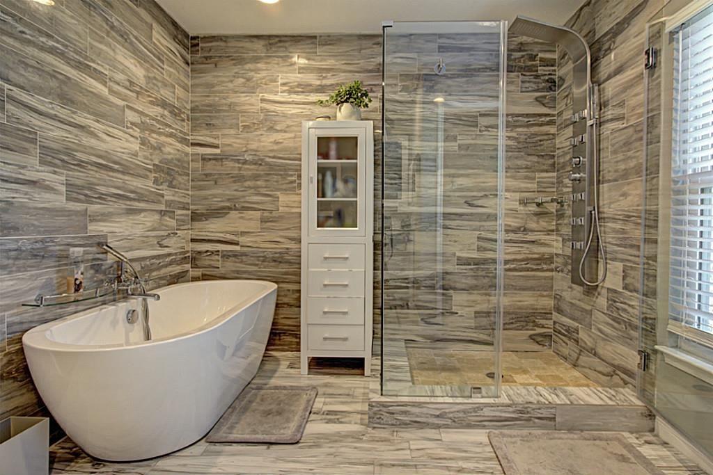 This spa master bath features Italian ceramic tile, Soaking tub and ...
