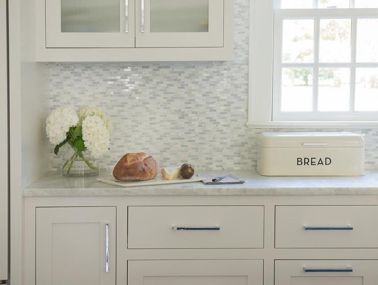 White And Gray Kitchen Boasts White Cabinets Adorning Polished
