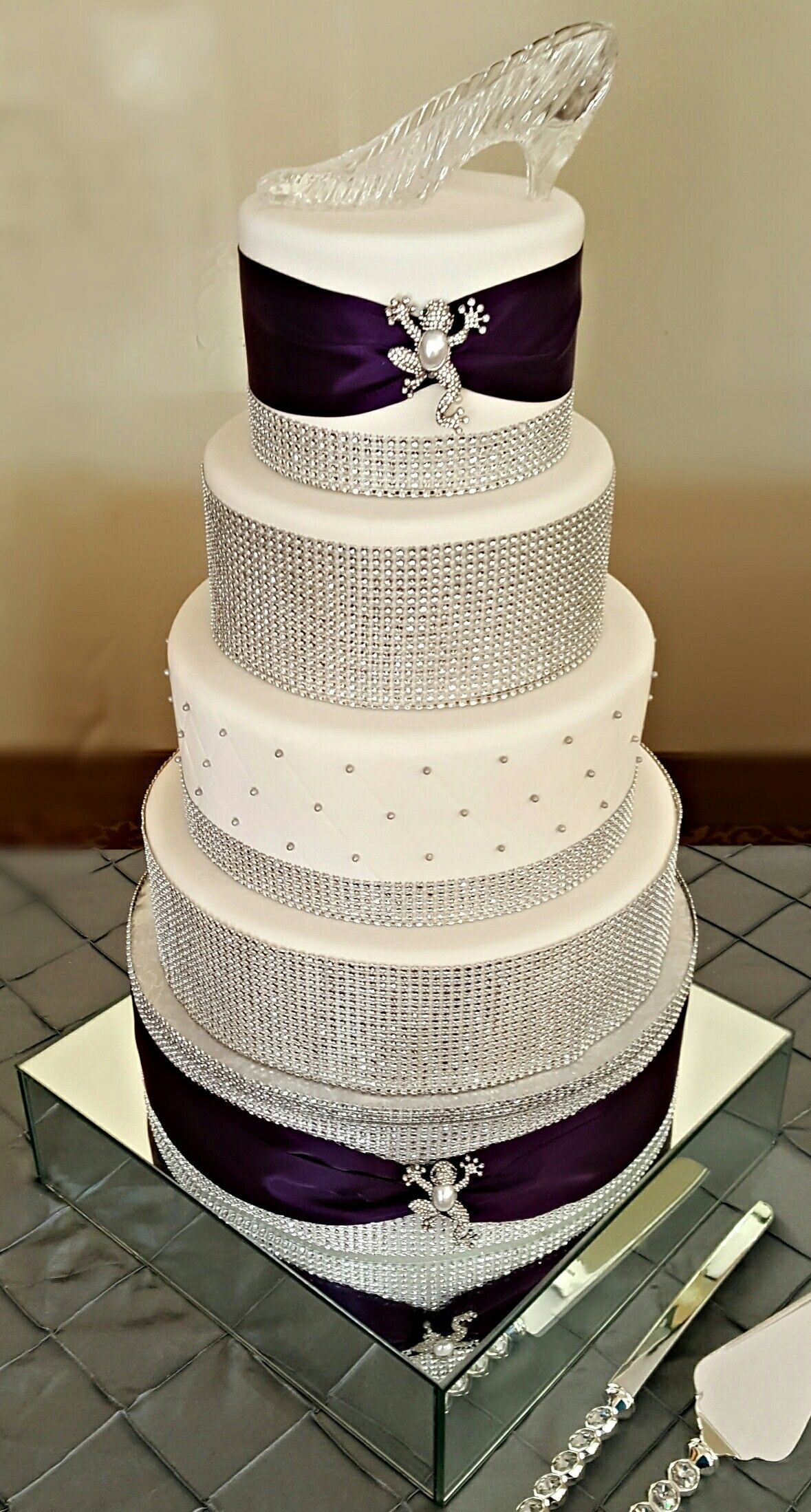 Custom 5 Tier White Fondant 50th Birthday Cake With Royal Purple Ribbons Rhinestone Bling Frog Brooches And Topped A Cinderella Glass Slipper Fit For