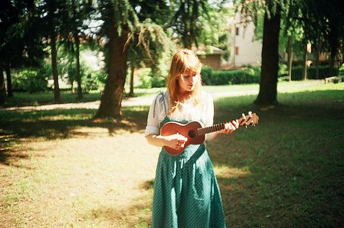 """Suddenly Kevin's eyes boggled. The girl was picking up her ukulele. And now she was strumming it. And now she was singing! Strumming away, bobbing her head and shoulders, singing, """"I'm looking over a four-leaved clover that I overlooked before."""""""