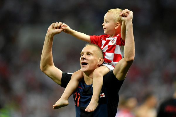 Domagoj Vida Photos - Domagoj Vida of Croatia celebrates victory with his child after the 2018 FIFA World Cup Russia Semi Final match between England and Croatia at Luzhniki Stadium on July 11, 2018 in Moscow, Russia. - England vs. Croatia: Semi Final - 2018 FIFA World Cup Russia