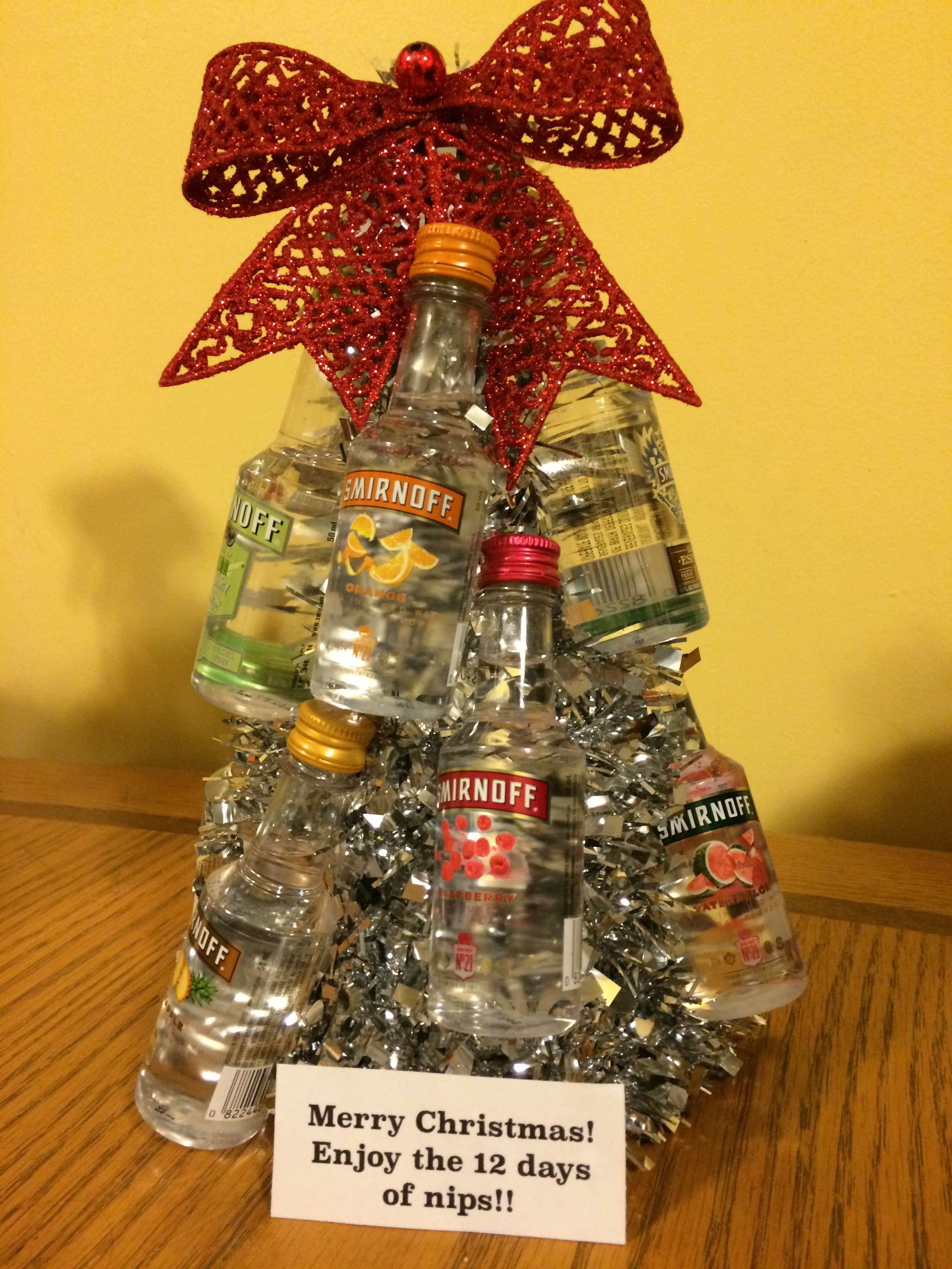 Just made this for my Yankee swap for work. Very easy dollar tree Christmas tree some thin wire to wrap the nips on the tree and bow for the top.