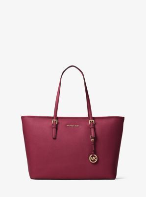 92e934e1fd0e A cool classic, the Jet Set Travel tote is crafted from our signature Saffiano  leather. Subtle logo hardware parallels its minimalistic vibe, ...