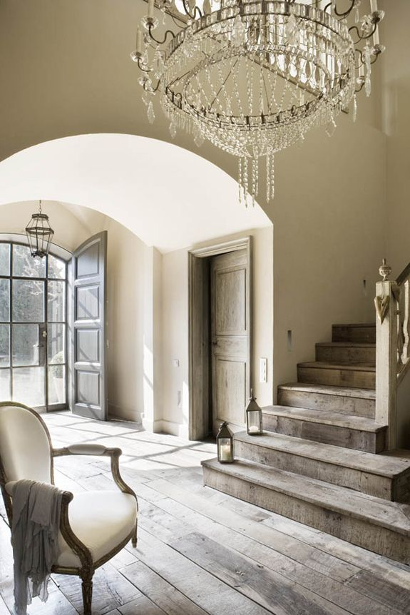 Entry ideas. Don't like chandelier or rustic wood but like the layout-and there are solid doors to close front glass-everyone looking in