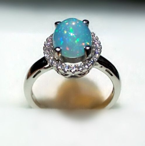 Inexpensive Antique Halo Opal Engagement Ring in Sterling Silver  http://www.jewelsin.com/p-inexpensive-antique-halo-opal-engagement-ring-in-sterling-silver-1234