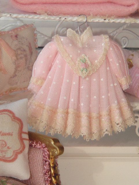 Beautiful girl dress made in cotton fabric and adorned with Valencias lace and silk ribbon. Each dress is embroidered by hand so it makes one of a kind.