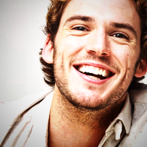 I am actually in love with his smile. I mean those dimples <3