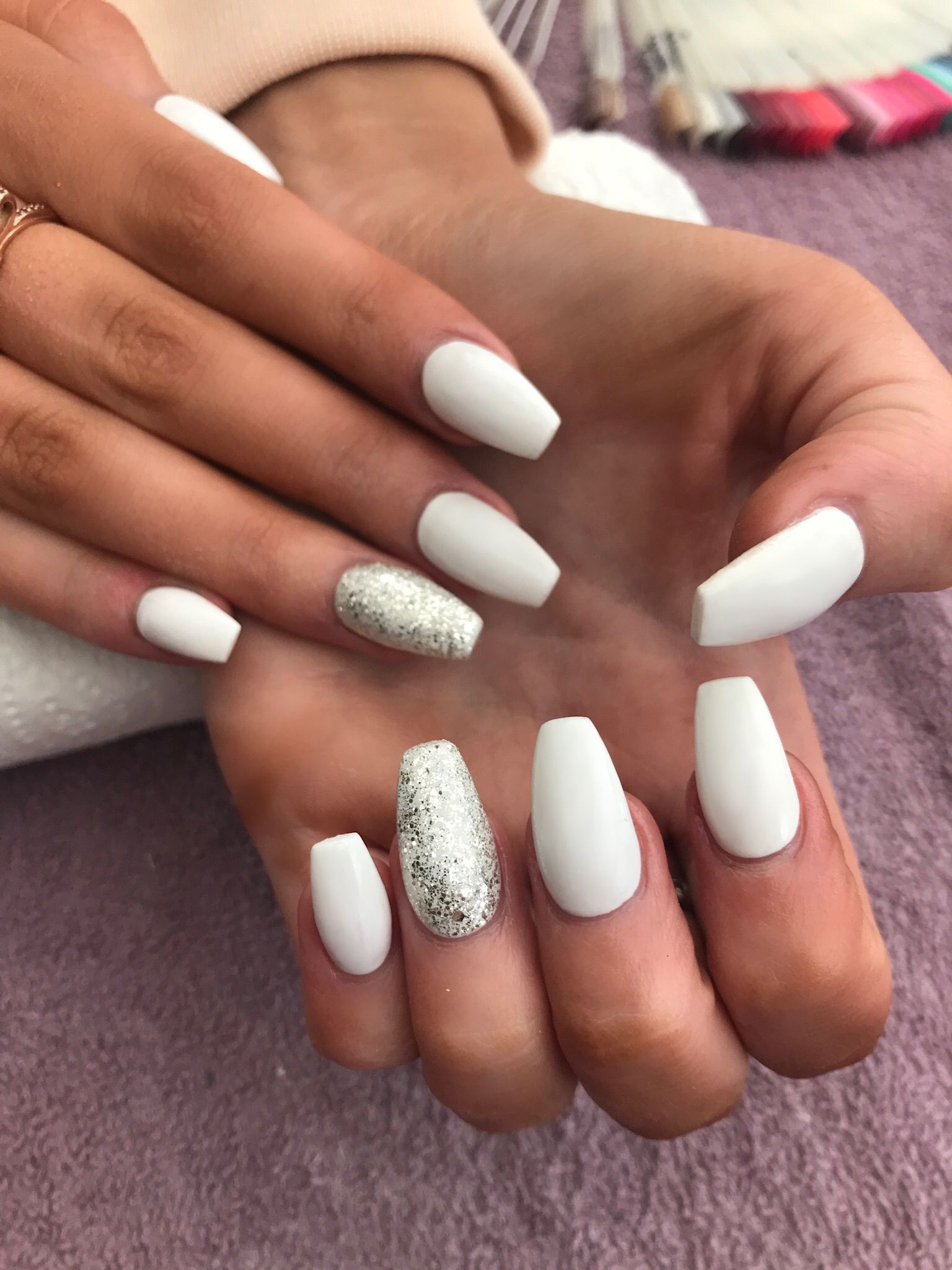 White coffin shaped acrylic nails with silver glitter accent nail ...