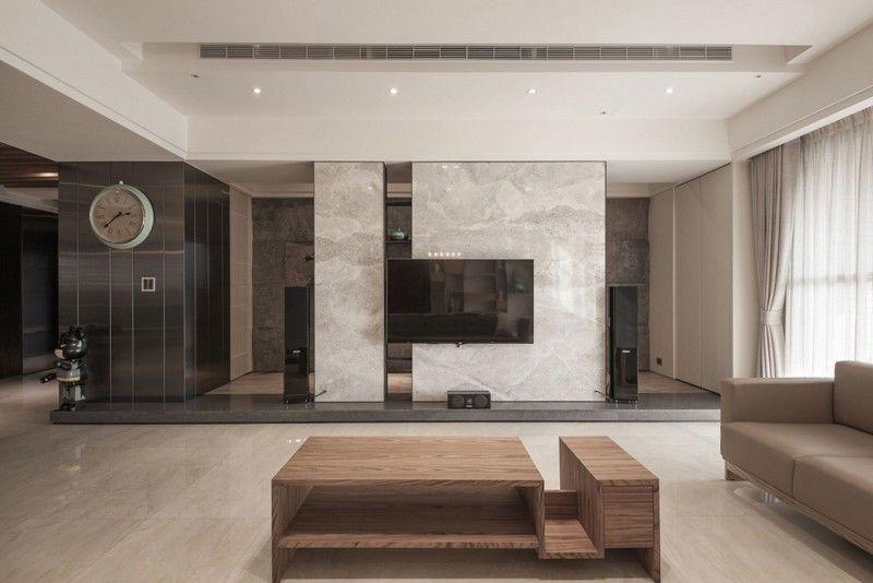 Wohnzimmer mit Marmor-Wohnwand und Möbel in neutralen Farben
