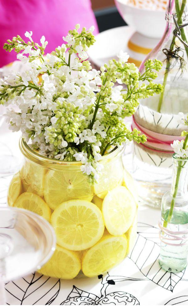 Spring Fling Party Tip #3: For a fresh perspective on vases, add slices of fruit to a flower-filled vase.