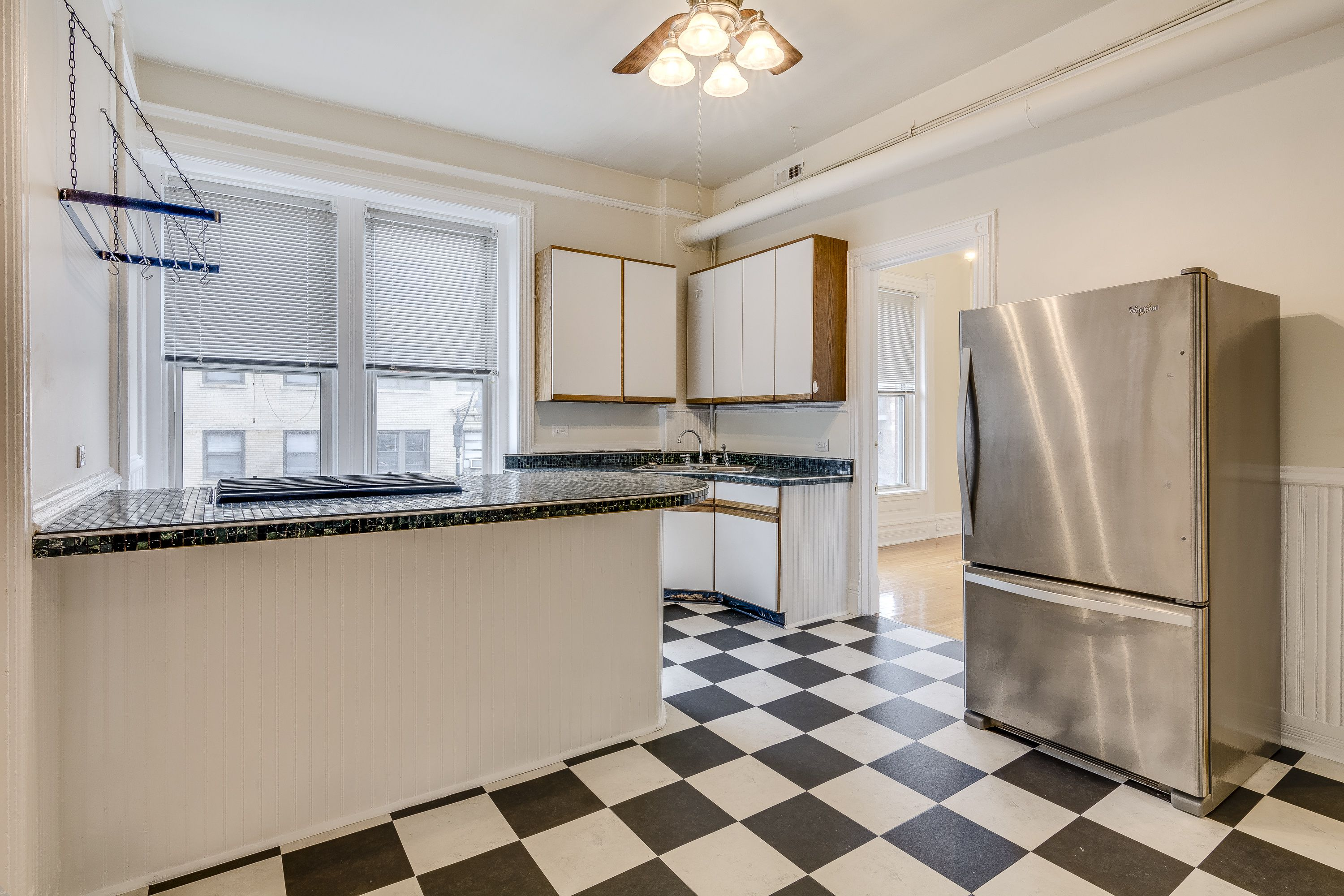 Retro style kitchen with stainless steel appliances, black