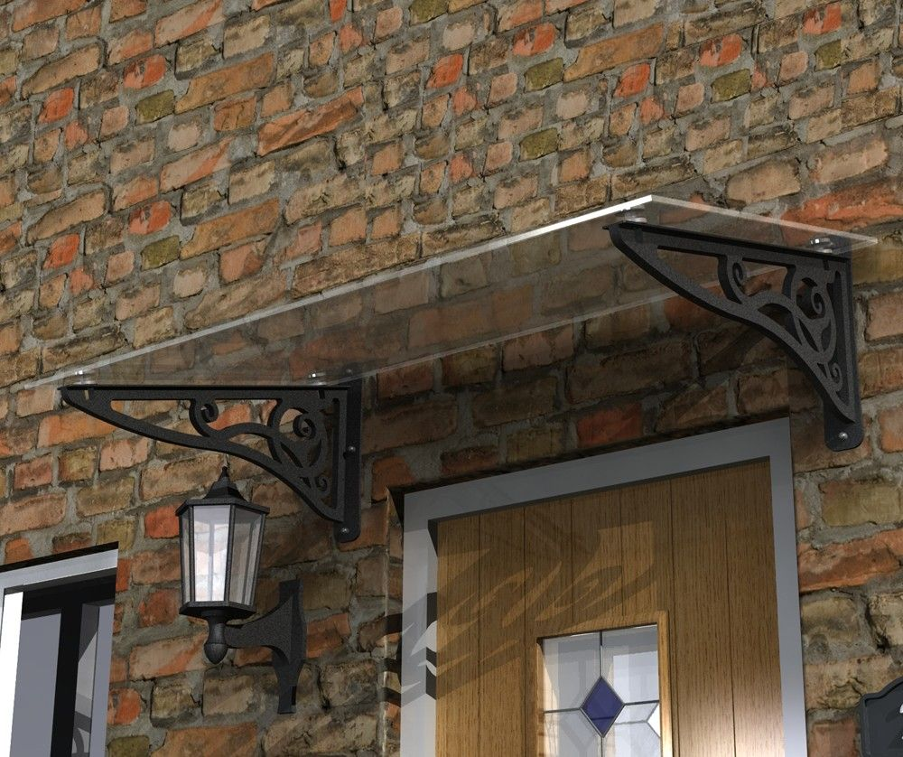 glass door canopy with scroll brackets. complies with uk snow load