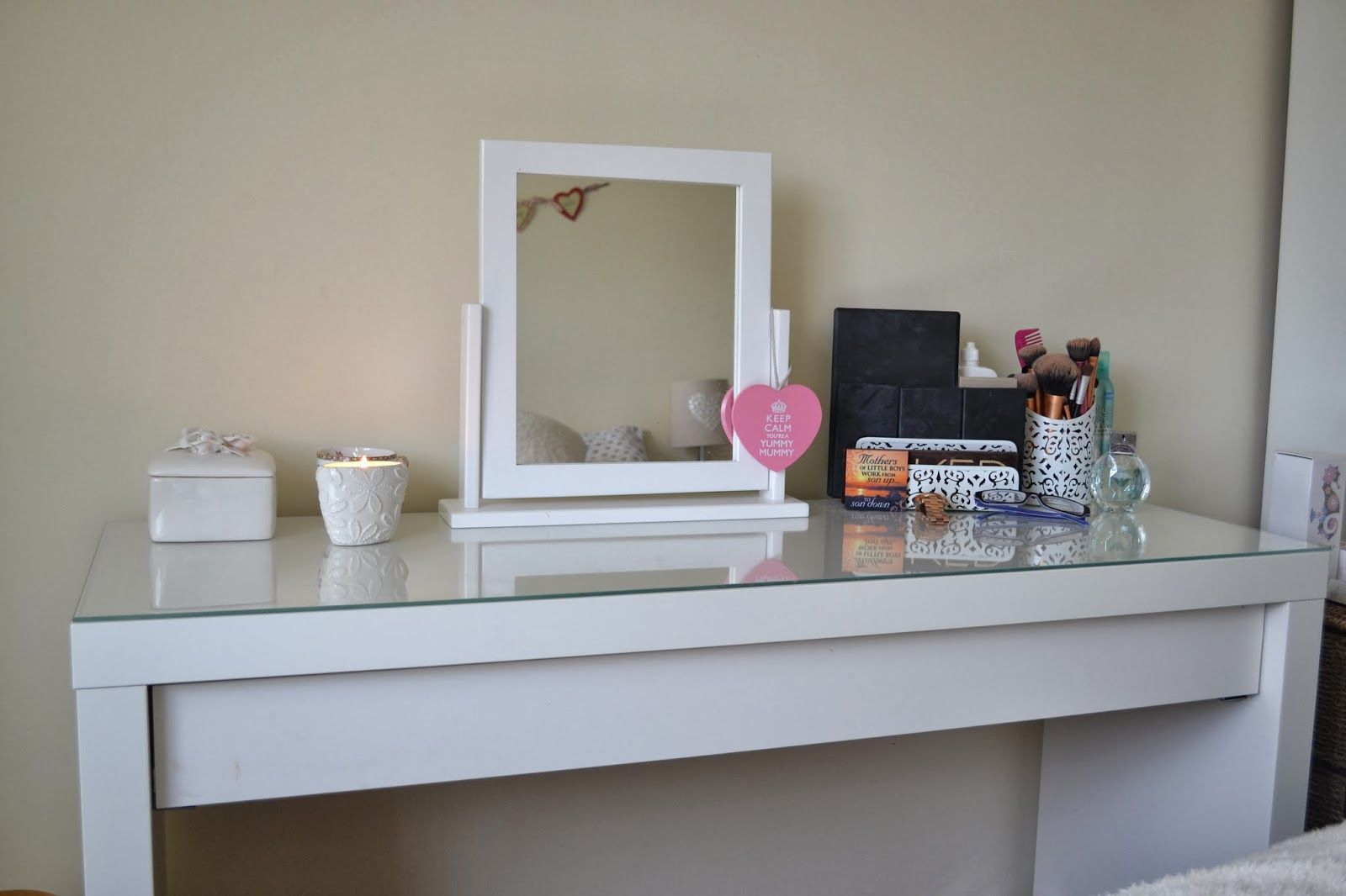 Master bedroom wardrobe designs inside  The surface is large enough to place nail polish and other