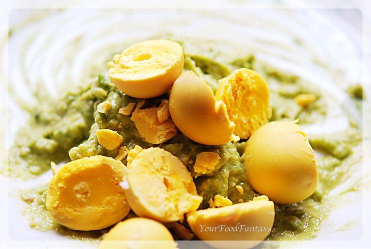 mashing avocada and egg york for avocado eggs at your food fantasy