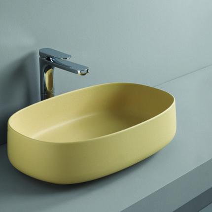 Vasque oblongue 55 x35 cm en céramique jaune à poser sur plan de