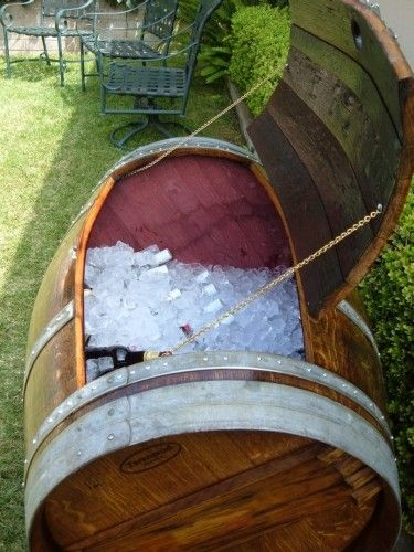 Barrel Ice Chest... so cool and would be very low key! and something you guys could then use at the house!