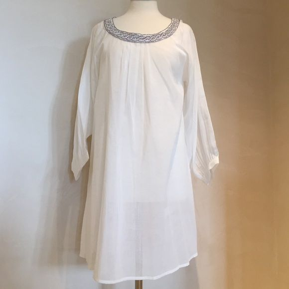 Beaded white beach dress Light cotton white dress with silver and white bead detail . Perfect for a tropical getaway . Brand new. Never worn Dresses