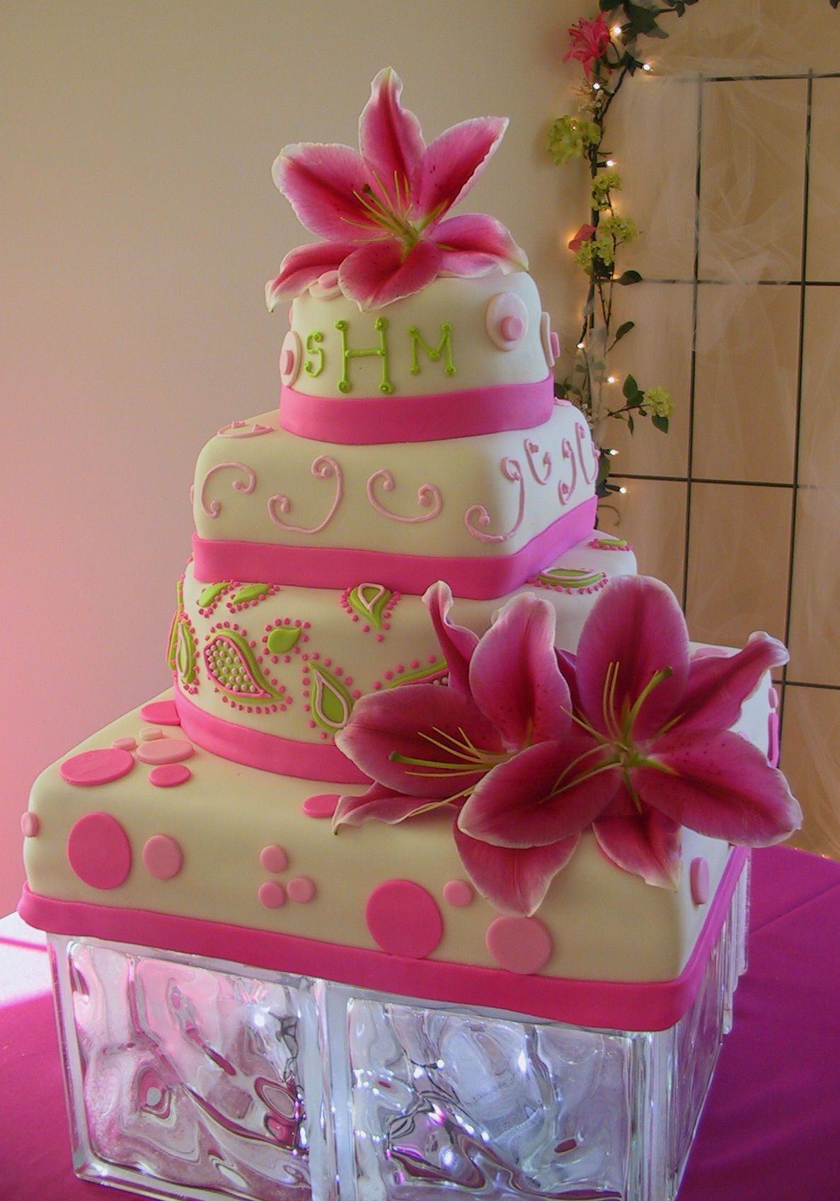 hot wedding cakes fondant stargazer lilly pink lime green and paisley 15343