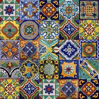 Love the use of Mexican tiles in kitchens, patios, bathrooms, around a door etc... sleepysarah