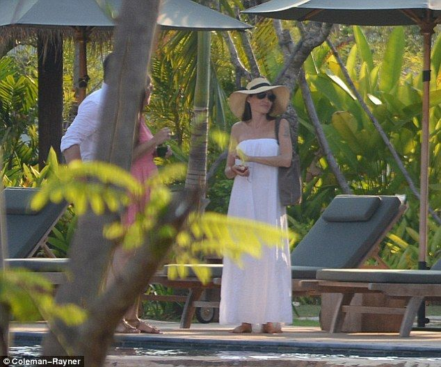 Kicking back: After months of hard work, Angelina showed off a big smile as she was seen r...
