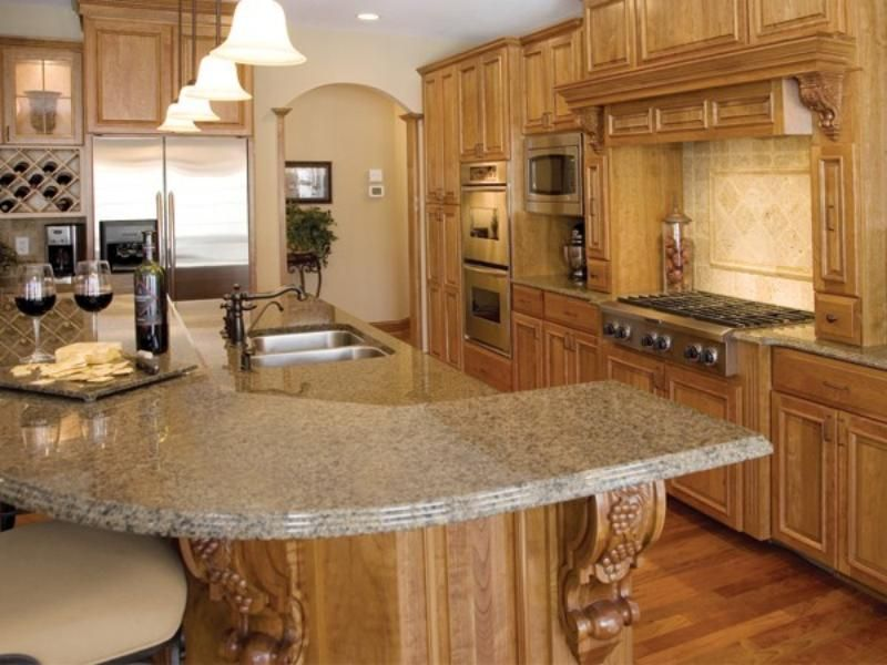 The Focal Point Of This Kitchen Is The 12 Foot Island Perfect For Frequent Entertaining Brown Granite Countertops Beautiful Kitchens Tumbled Travertine Tile