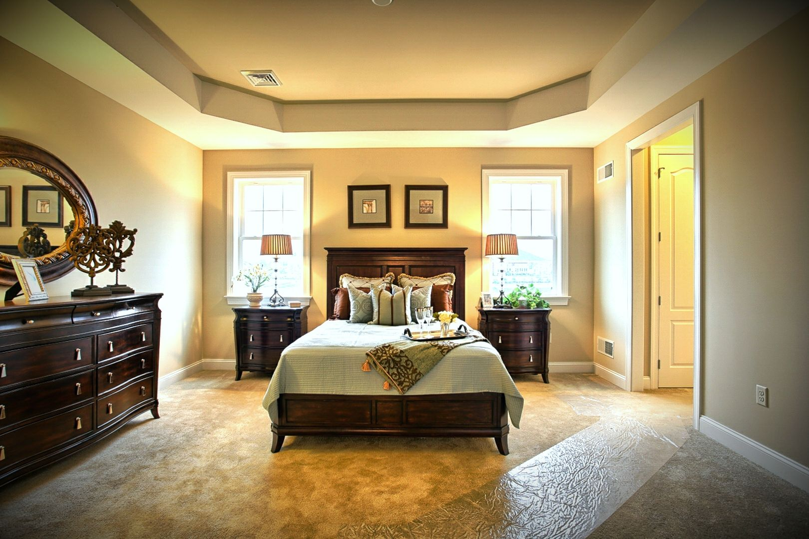 Master bedroom suite with adjoining master bathroom and