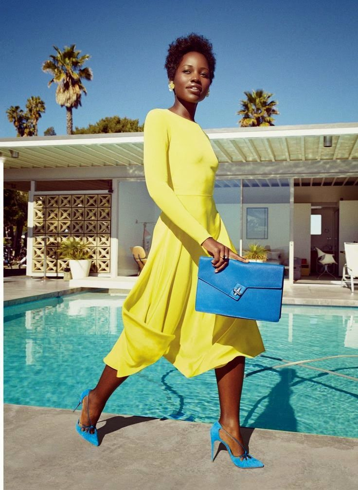 Lupita Nyong O In A Bright Yellow Dress With Blue Clutch