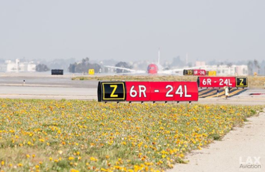 Beautiful Flowers Line Up Along 24l As Norwegian Airlines Prepares To Depart Airplanesoflax Pic C Norwegian Airlines Los Angeles International Airport Lax