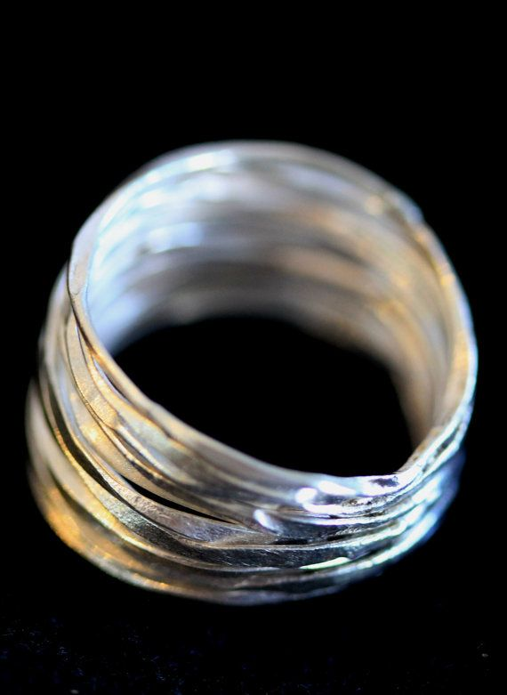 We used long, continuous silver wire which we hammered and twisted and then applied in 14 loops to create the shape of the ring. The ring is lower at the back where the wire is joined together and opens up to be at its widest at the front. It is elegant and lightweight, adapt for special occasions as for everyday wear.  We can make this ring and have it shipped in about 2-3 weeks after ordering. We usually make sizes 5-9; however, let us know in case you need the size personalized for…