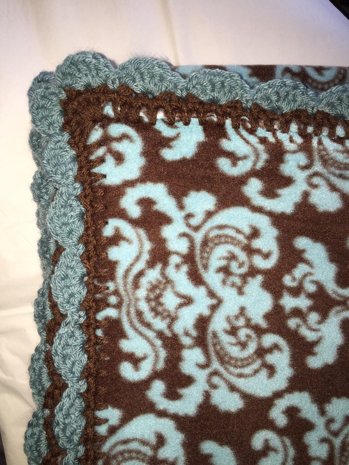 A personal favorite from my Etsy shop https://www.etsy.com/listing/230606054/brown-and-blue-60x40-hand-made-crocheted