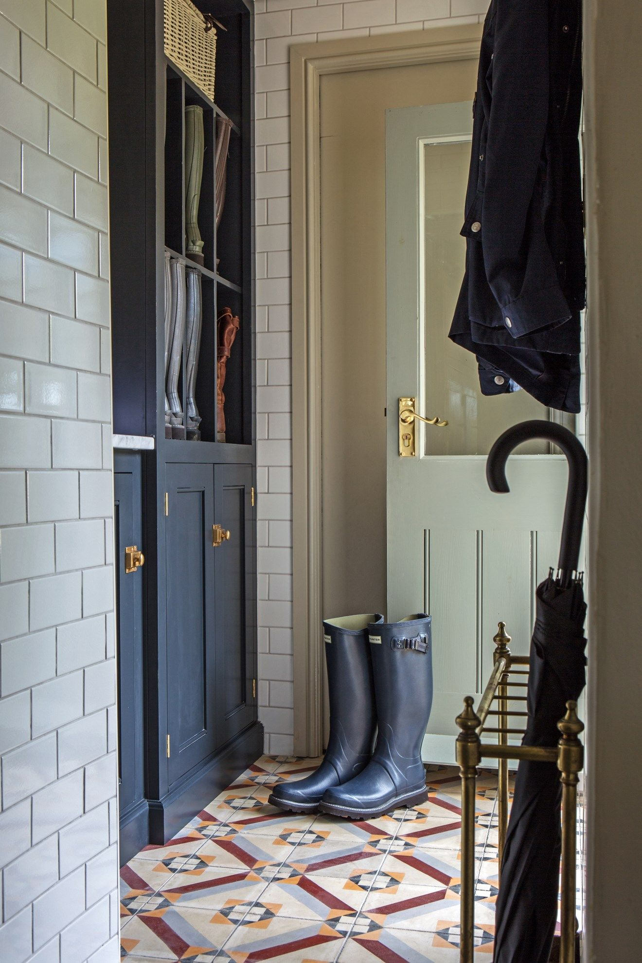 Quaint Mudroom with Tile Walls
