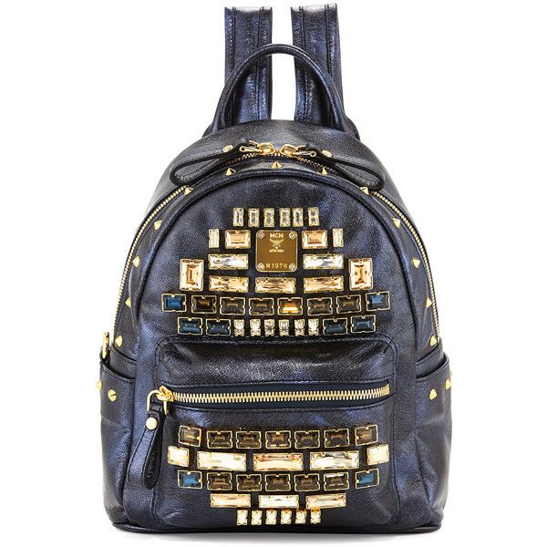 MCMStark Edeline Mini Backpack, BlueDetailsMCM backpack in metallic leather with golden hardware. Stud and faceted crystal embellishment. Looped top handle; 2 …