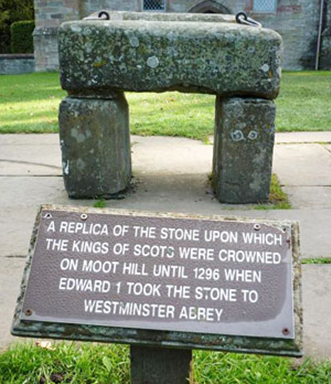 A replica of The Stone of Scone, also known as The Stone of Destiny, at Moot Hill, Scone Palace, in the village of Scone, Perth and Kinross, Scotland. | Having been returned to Scotland by England, the original Stone of Destiny is now at Edinburgh Castle.