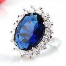 Kate Middleton wears a Ceylon Blue Sapphire engagement ring, famously picked out by Prince Williams mother, Princess Diana of Wales for her own engagement in 1981. The ring itself, crafted by the Crown Jewellers  Asprey  Garrard of London, at the time was valued at US$ 50,000, is now estimated to be worth US$ 500,000. The piece is an oval cut, 18-carat Ceylon Sapphire  of a particularly vivid shade of Cornflower Blue.