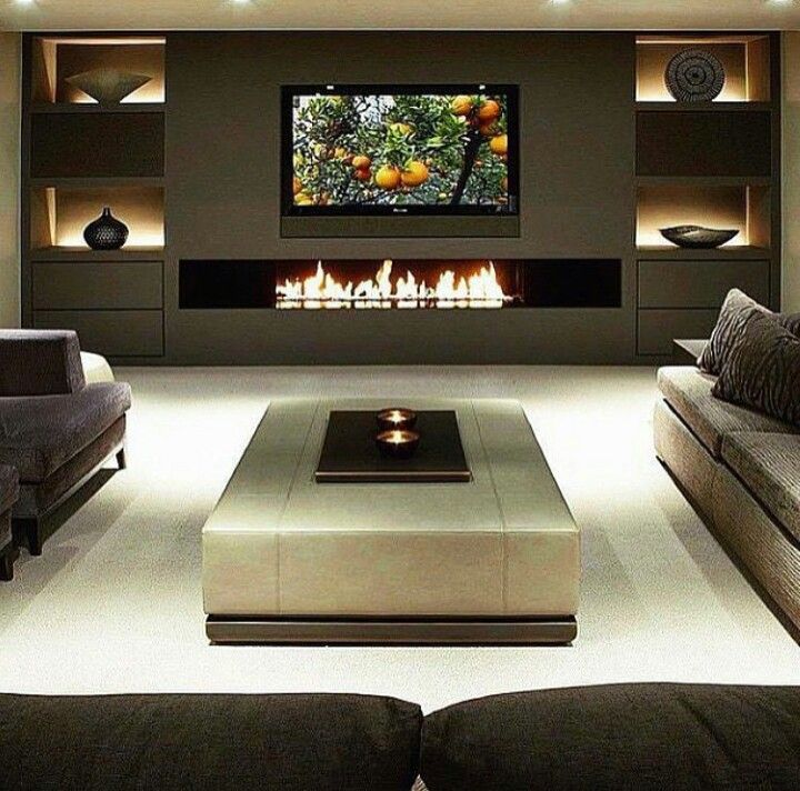 Modern Den Or Living Room Area Sectional Sofa With Fireplace And Backlit Shelves Fla Living Room Design Modern Living Room With Fireplace Living Room Tv Wall