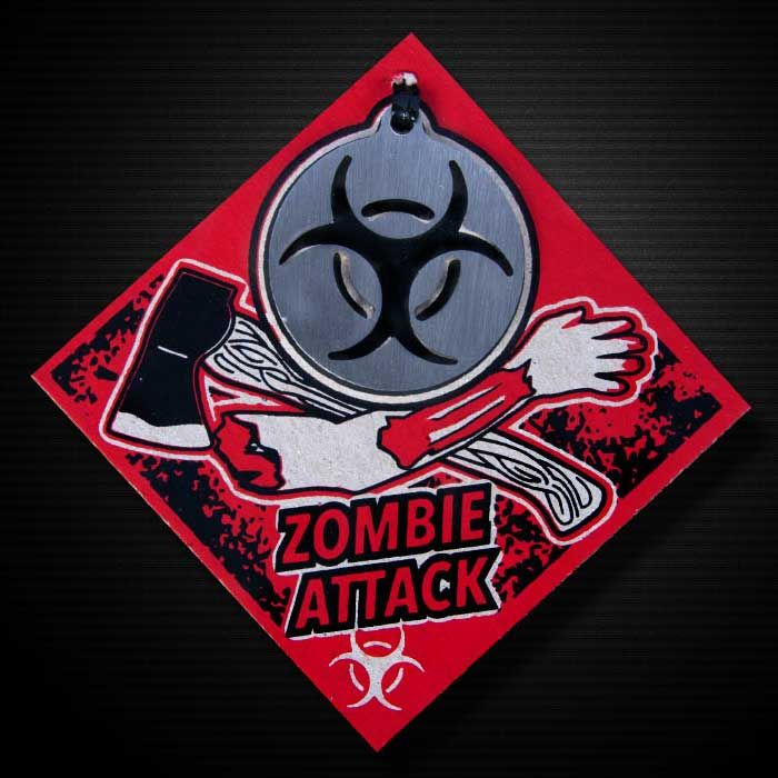 """ZOMBIE ATTACK KEYCHAIN BY CRRANKY It's a proven fact that zombies are a biohazard. That is, they pose a threat to the health of living organisms. True.  So gear up. You know it's coming.  The Zombie Attack Keychain is a part of the Apocalypse Series.  Includes thick-heavy 13 gauge, 1.5"""" diameter, stainless steel Zombie Attack medallion, 2 color hand screen printed chipboard package and 6 inch steel cable keychain.  Crafted with attitude in Kansas, USA."""