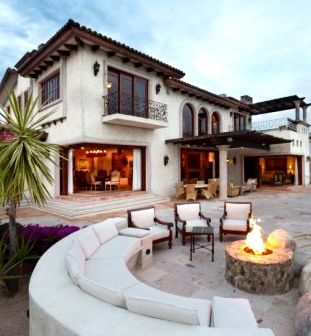 Spanish style home with outdoor entertaining area