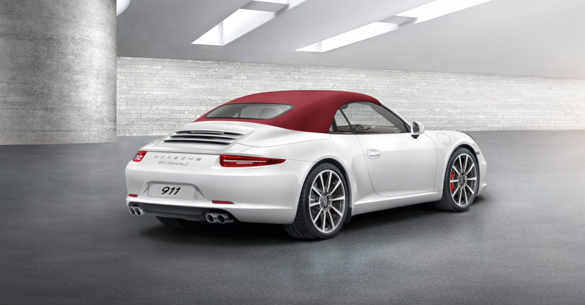 right right side rear view of a white porsche 911 carrera s cabriolet if you