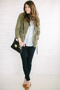 olive jacket, white blouse, jeans and flats.